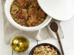 Not everyone has a jar of preserved lemons hanging out in the fridge, but after giving this recipe for Preserved Lemon Chicken with Olives with Almond Couscous a go, you might consider it. Adapted from our poultry-centric cookbook of the week, Poulet, this recipe brings together a trio of salty-fantastic ingredients—capers, olives, and those great preserved lemons)—to make a pot full of falling-off-the-bone braised chicken thighs.