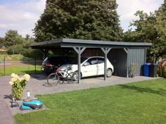Carport mit Schuppen und Fahrradständer
