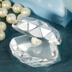Bring a sparkling luxury to a beach theme when you use Diamond Oyster and Pearl Memento as part of the table decor and gift for friends and family to take home.  As Low As $1.85 http://www.topweddings.com/diamond-oyster-and-pearl-memento.html #clam #pearl #weddingfavor