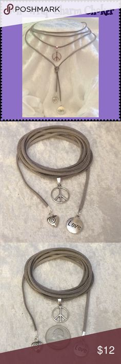 """Grey Faux Suede Boho Wrap Hippie Charms Choker 72"""" This grey vegan faux suede 3/8""""W Peace & Love boho wrap choker is 72"""" long. Tibetan silver large Peace Sign, LOVE disk & Heart charms. Can be worn/tied many ways or as wrap bracelet. Handcrafted by me.   Can be made longer or shorter. 21 colors available. For different color/charms ask for custom order.  Jewelry items priced firm as a single purchase due to material cost & PM fees.   Bundle special on guitar pick/choker/charm jewelry ONLY…"""