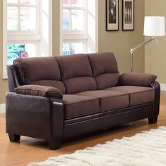 @Overstock - Bold in design and accent, the Morena sofa will pair well your contemporary design aesthetic. Dark brown microfiber seating is highlighted with contrasting vinyl cording and side panels.http://www.overstock.com/Home-Garden/Morena-Dark-Brown-Microfiber-Vinyl-Sofa/7338204/product.html?CID=214117 $477.99