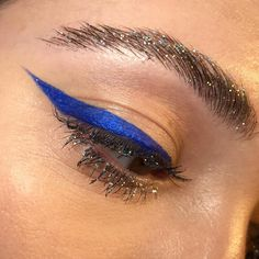 Blue liner with glitter lashes and brows