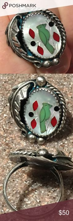 Native American Zuni Bird Ring Tested Sterling, not marked. Has makers initial T. Beautiful mother of pearl looks like a rainbow in the right lighting. Ring has MOP, Coral, Onyx and the green is either turquoise or Gaspeite ) very well made vintage Sterling silver ring. Has a large leaf along one side. Almost has a Shadowbox look to it. See all pictures for size Jewelry Rings