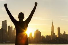 Successful woman in New York sunrise