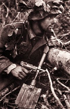 Soldier with a Spade and a Luger pistol. Loading that magazine is a pain! Get your Magazine speedloader today! http://www.amazon.com/shops/raeind