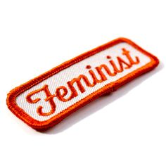 "Yes all women - Embroidered patch with merrowed edge - Iron-on adhesive backing - Measures 1"" tall x 3"" wide"