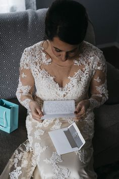 Bride reads letter from groom on wedding day.
