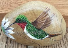 pretty hummingbird handpainted rock,bird paintings on rock