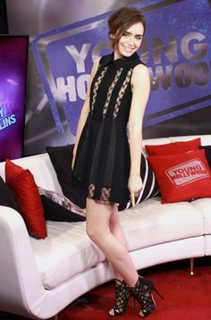 Lily Collins wearing Jimmy Choo Fonda Black Lace and Suede Booties Thakoon dress  Young Hollywood Studios August 10 2013