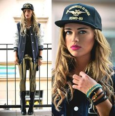 varsity letterman jacket + logo baseball cap + metallic gold leggings + black combat boots