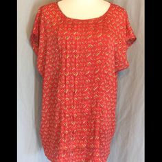 NWOT Liz Claiborne Coral Polyester Blouse New without tags, no defects. Little paisley designs in gold and green. Pin tuck pleats down the front. Small slits at side hemline. Bust 28 inches flat. Length 30 inches. Liz Claiborne Tops Blouses