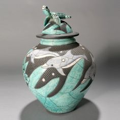 792: ROBIN RODGERS Raku pot with Dolphins and Turtles. : Lot 792