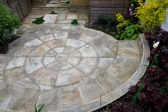 Flooring in the space will be on the form of an Indian sandstone circle measuring 3.6m in diameter. Asection of the outer ring will be elevated to form the a seat fronting a raised planting bed in the bottom left of the space.#courtyard #eastlondon #terracegarden