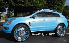 ♡ 2011 Cadillac SRX on 32 inch rims... plus the color. .. bossy
