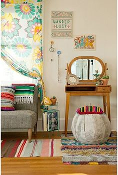 not sure what I love more: the mix of prints and stripes, the cool mini desk/ mirror or the wander lust on the wall.