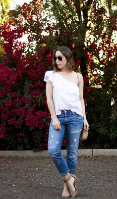 Dressing Down a Ruffle One Shoulder Blouse | Clothes & Quotes. White one shoulder eyelet top+boyfriend jeans+camel ankle strap heeled sandals+camel chain crossbody bag+aviator sunglasses. Summer Casual Weekend Outfit 2017