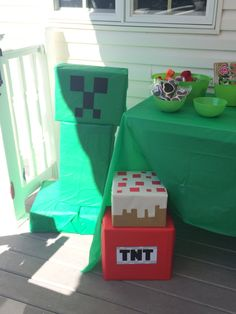 Creeper, cake, and TNT made from old boxes, tablecloths from the Dollar Store, and wrapping paper. Minecraft Birthday Party, Boy Birthday Parties, Creeper Cake, Minecraft Costumes, Gamer Room, Old Boxes, Tablecloths, Dollar Stores, Birthdays