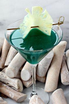 Seven Seas Martini: 1 ounce amaretto, 1 ounce malibu rum, 1 ounce blue curaçao, 1 1/2 ounces pineapple juice