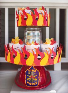 Amazing fire truck birthday party theme! We love this DIY cupcake stand in particular.
