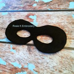 New to RosieKEmbroidery on Etsy: Felt Superhero black Super Hero/ Bad Guy childrens Pretend Dress up mask Party favor Costume for pretend Dress up church play school play (5.99 USD) Halloween Costume Felt Superhero Mask Superhero Party First Birthday Dramatic Play Travel Game Busy bag Travel Quiet Book Comic Book Favor Black Costume Ball Black Superhero Mask Felt Robber Mask Felt Bad Guy Mask