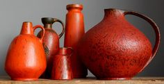 Here we have a fabulous set of FIVE vintage 1960s RUSCHA vases. The vases come in a glaze called Volcano designed by Otto Gerharz. The set cosists of a large Ruscha form 315, and forms 320, 328, 321 and 848. Measurements: vase 315 height 22.5 cm (8.86), width 24 cm (9.5), vases 848 height 25.5 cm (10), width 8 cm (3.1), vase 328 height 9.5 cm (3.7), width 7 cm (2.76), vase 321 height 20 cm (7.87), width 9 cm (3.54) and vase 320 height 18 cm (7), width 11 cm (4.33). Total weight - 3.230 kg…