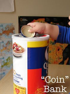 """""""coin"""" bank- oatmeal container with baby food jar lids"""
