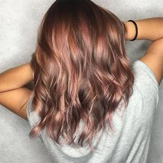"""Finally! A pastel trend that brunettes can get involved with! The [link url=""""http://www.glamourmagazine.co.uk/article/the-most-wearable-hair-trend-yet-rose-gold""""]rose gold trend[/link] isn't done just yet, as rose brown is [link url=""""https://www.allure.com/story/rose-brown-hair-color-trend""""]gaining traction[/link] on Instagram. Instead of having to dye your hair bright blonde to achieve the look, this works with darker hair colours. Created by hairstylist [link…"""