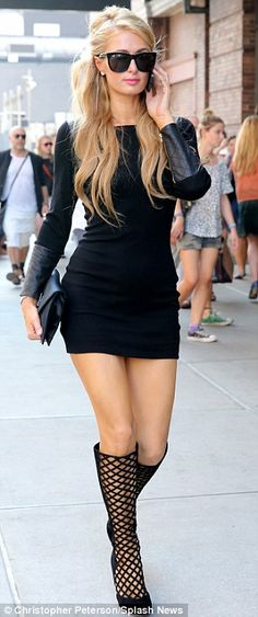 Quick change: Paris Hilton began her day in a black outfit before changing into a more feminine outfit as she show-hopped at New York Fashio...