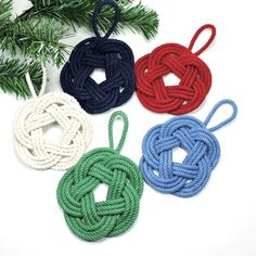 """These handmade ornaments are cotton and measure about 3 1/4 inches across and with the loop are about 6"""" long. With our nautical knot ornaments, you can create an all-out seaside Christmas theme or ad"""