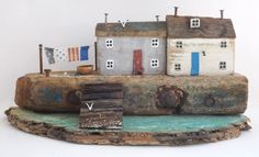 Chunky Cottage with Steps into a Turquoise Sea by Kirsty Elson Kirsty Elson, House Ornaments, Driftwood Art, Wooden Crafts, House In The Woods, Little Houses, Vintage Wood, Creative Art, Wood Houses