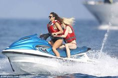 Rush: The 26-year-old was all smiles as she handled the jet ski