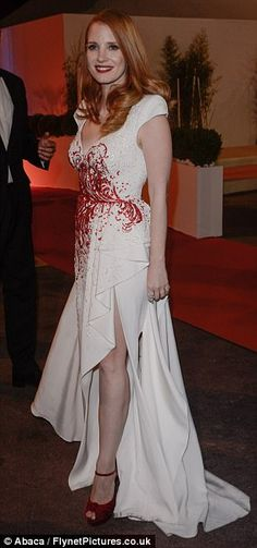 Statuesque: The actress added height to her frame with towering red velvet heels as she po...
