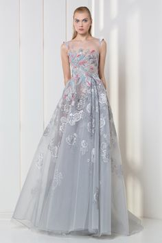Silver A-line tulle dress featuring lace flowers and colorful velvet patchwork embroideries on the bodice.