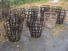 """Large metal basket that hold and protect large glass wine bottles in France."""
