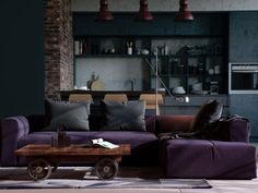 http://boomzer.com/transform-industrial-room-becomes-amazing-also-roomy-apartments/visualizer-alex-koretsky-indigo-sofas-the-exposed-brick-fairytale-chandelier-and-plush-purple-sofa-femine-apartments-rolling-coffee-table-breakfast-bar-bars-chair-wooden-floor-kitchen-cabinets/