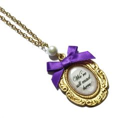 We're all mad here! Vintage style Alice in Wonderland necklace found on Polyvore
