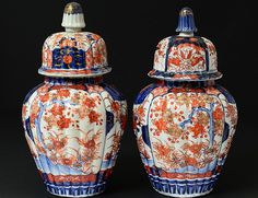 "PAIR OF IMARI PORCELAIN JARS AND COVERS - Japanese. Circa 1900. Each with ribbed body and cover. Height 9 3/4""."
