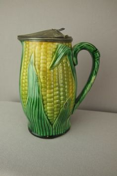 """Majolica corn syrup pitcher with pewter top, 6"""""""