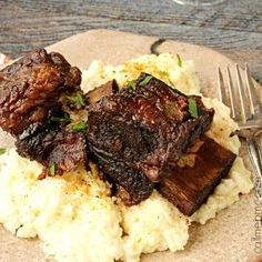 Braised Short Ribs are the Best Damn Short Ribs you'll ever have! These short ribs are cooked in red wine until falling-off-the-bone tender!