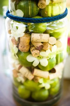such a pretty mixture - wine corks, apples and flowers