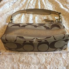 Coach purse Gold tan with brown C gold leather brass hardware 10 x 4 1/2 x 3 used good condition some markings on inside from makeup Coach Bags