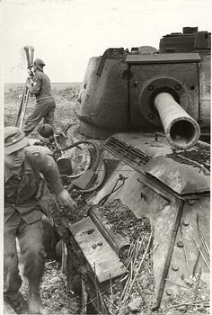 German soldiers near destroyed T-34-85 tank
