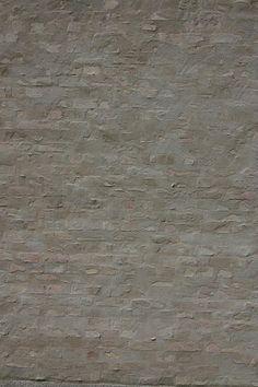 am kupfergraben 10, David Chipperfield. brick facade with mortar render brought to brick face