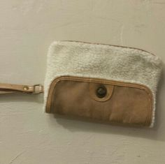 Bath &  body works clutch purse! Cream and brown colored sheep skin and leather looking clutch purse from bath & body works! It has 2 nicks in the handle but still really awesome! Bath & body works Bags Clutches & Wristlets