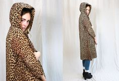 Vintage 1960s amazing corduroy leopard print swing coat with cloak like hood. In excellent condition with matching button closure at top. Front pockets, fully lined. One size fits most.  Measurements >>>---> Sleeve: 20 Shoulder to Shoulder: 21-23 inches Armpit to Armpit: 23-24 inches Waist/Hip: Open Length: 44 inches
