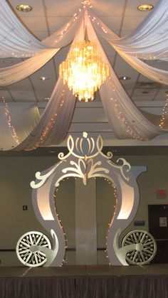 This stunning ceiling and carriage will make any bride feel like Cinderella on her special day.