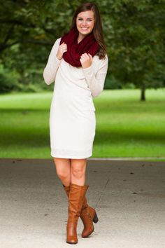 """With a stunning neckline and a gorgeous cream color, this fall dress is soirée ready! You can make it casual with boots or a little more uptwon with heels! No matter the way you style it, you'll have a beautiful look on your hands! <br /> <br />Bra-friendly! Material has generous amount of stretch. Fully-lined! <br />Sara is wearing the small.  <br /> <br />Sizes fit: <br />Small- 0-4; Medium- 6; Large- 8 <br />Length from shoulder to hem: S- 40""""; M- 41""""; L- 42""""."""