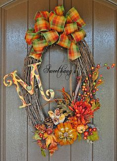 Fall Harvest Grapevine Wreath by Sweethangs on Etsy. Like this shape for my door window.