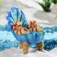 Seashell Under the Sea Chair www.teeliesfairygarden.com . . . This beautiful seashell chair that is befitting for any mermaid royalty will add a majestic vibe to your garden. #fairychair