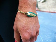 Green and Gold Fishing Lure Bracelet. $12.50, via Etsy.